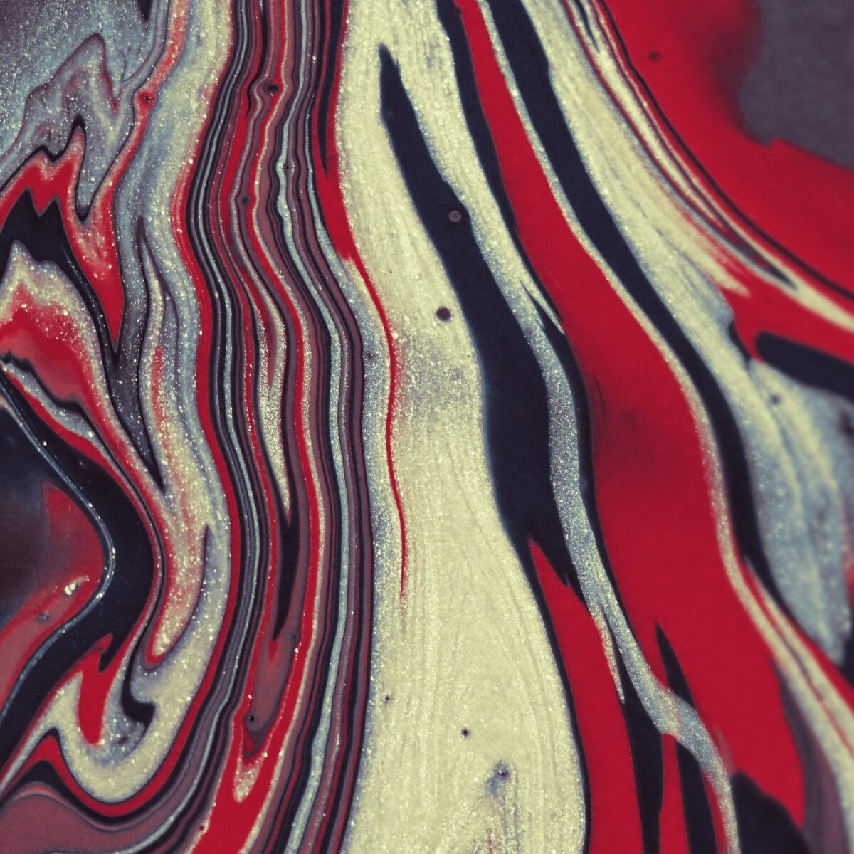 Abstract art painting with red, white and black tones by Anni Roenkae